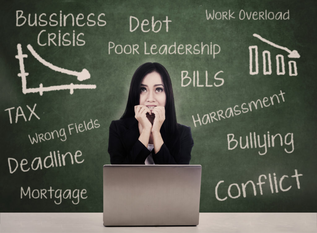 Business woman with laptop fears debt crisis