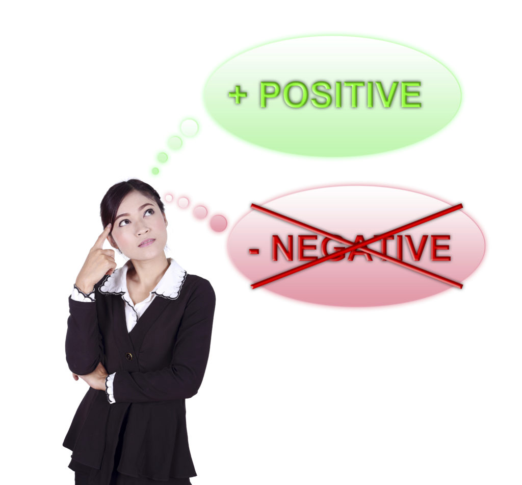 Business woman thinking about positive thinking isolated on white background